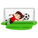 Goalkeeper Boy trying catching the ball on football gate Stock Photo