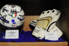 Goalkeeper Buffon gloves and ball Royalty Free Stock Photography