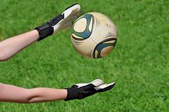 Goalkeeper catches a ball Royalty Free Stock Photos