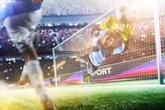 Goalkeeper catches the ball on the soccer stadium Stock Photography