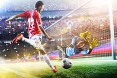Goalkeeper catches the ball on the soccer stadium stock image