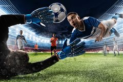 Goalkeeper catches the ball in the stadium Stock Photo
