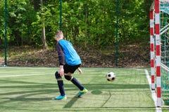 Goalkeeper catches the ball. Stadium goalie sports play ground game, grass soccer keeper man, outdoorsc ompetition. Goalkeeper catches the ball. At the stadium stock photography
