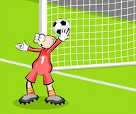 Goalkeeper catching the ball Royalty Free Stock Photo