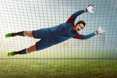 Goalkeeper catching ball Royalty Free Stock Photography
