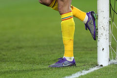 Goalkeeper cleaning his boots Royalty Free Stock Image