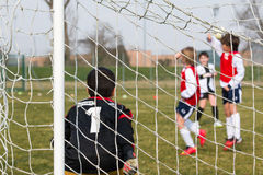 Goalkeeper, defenders on wall and little soccer player for a pen Stock Photos