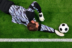 Goalkeeper diving to save the ball stock photos