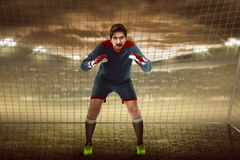 Goalkeeper in front of goalpost Stock Images