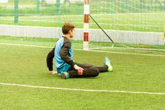 Goalkeeper and goal at the football field, warms up before soccer game. Goalkeeper and goal at the football field, warms up before soccer children game Stock Image
