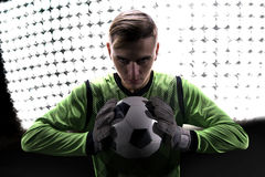 Goalkeeper in green ready to save on highlights. Goalkeeper in green ready to save on the highlights royalty free stock photos