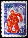 Goalkeeper of the hockey team, dedicated to the winter Olympic games in Sapporo, Japan, series, circa 1972. MOSCOW, RUSSIA - APRIL 2, 2017: A post stamp printed Stock Photography