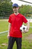 Goalkeeper hold soccer ball stock photography
