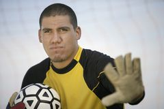 Goalkeeper holding ball Stock Photo