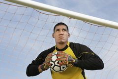 Goalkeeper Holding A Ball royalty free stock photography