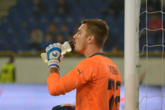 Goalkeeper Igor Litovka drinks water during a match Stock Images