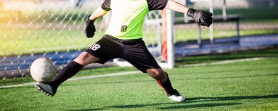 Goalkeeper kick ball to out of goal royalty free stock photography