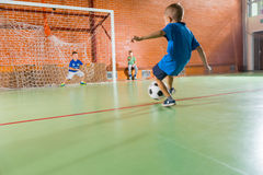 Goalkeeper kicking the soccer ball Royalty Free Stock Images