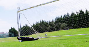 Goalkeeper misses a save in the field. On a sunny day stock footage