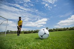 Goalkeeper ready to kick the soccer ball. In the ground Royalty Free Stock Photo