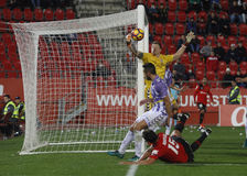Goalkeeper of Real Valladolid stopping a goal in a match. Mallorca, Spain- December 04, 2016 Royalty Free Stock Photos