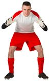Goalkeeper in red and white ready to catch. On white background royalty free stock photo