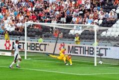 Goalkeeper returns the ball off target Stock Photo