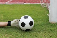 Goalkeeper's hands reaching ball Stock Images