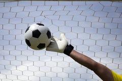 Goalkeeper's hands reaching foot ball Stock Photos
