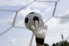 Goalkeeper's hands reaching foot ball Stock Photo