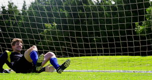 Goalkeeper saves a goal in the field