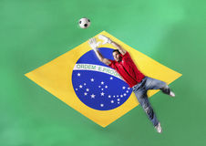 Goalkeeper saving ball in front of Brazilian flag Stock Images