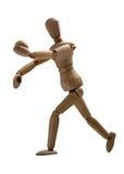 Goalkeeper serving a ball. Wooden model of goalkeeper serving a ball Royalty Free Stock Images
