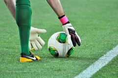 Goalkeeper stand the ball Royalty Free Stock Photo