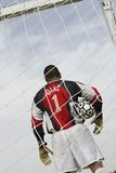 Goalkeeper standing in goal with ball Stock Photo