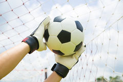 Goalkeeper used hands for catches the ball stock image
