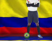 Goalkeeper in white with ball Stock Image
