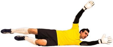 Goalkeeper in yellow making a save Royalty Free Stock Photos