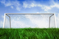 Goalpost on grass under blue sky Stock Image