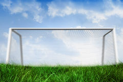 Goalpost on grass under blue sky Stock Photo