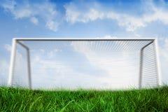 Goalpost on grass under blue sky Stock Photo