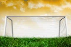 Goalpost on grass under yellow sky Royalty Free Stock Image