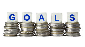 Goals. Stacks of coins with the word GOALS isolated on white background stock images