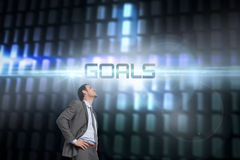 Goals against glowing codes on black background Royalty Free Stock Images