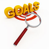 Goals or aims. Word goals on a target circle and under a lens, excellence in achievement of goals and targets concept Royalty Free Stock Image