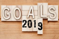 2019 goals banner - New Year resolution concept - text in vintage letters on wooden blocks.  stock image