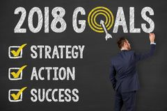 Goals 2018 on Chalkboard. Working royalty free stock photo
