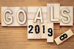 Goals 2018 change to 2019 concept. Wooden block cube with number. On table royalty free stock photo