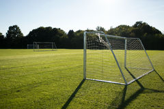 Goals on the football field. Green grass ready to play football, beautiful field Royalty Free Stock Photography