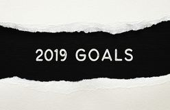 2019 goals list written over torn paper on black background. 2019 goals list written over torn paper on black background royalty free stock image